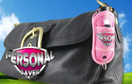 personal saver pepper spray clipped on a purse